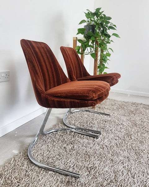 A very cool pair of mid century1970's brown velour and chrome cantilevered chairs
