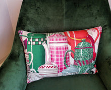 Load image into Gallery viewer, Bolster cushion made from fabric by Manuel Canovas featuring pink French enamel coffee pots!