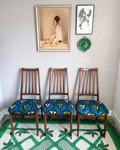Set of 4 elegant vintage mid century teak dining chairs reupholstered in African fabric.