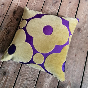Cushion made from Orla Kiely spot flower velvet in purple and gold