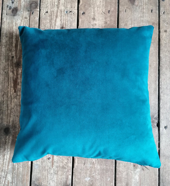 Moleskin velvet cushion in a teal blue colour