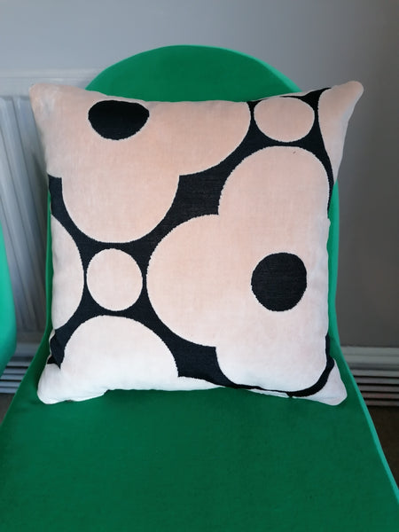 Cushion made from Orla Kiely spot flower velvet in black and tea rose