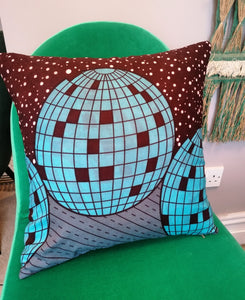 Disco ball cushion made from African wax fabric