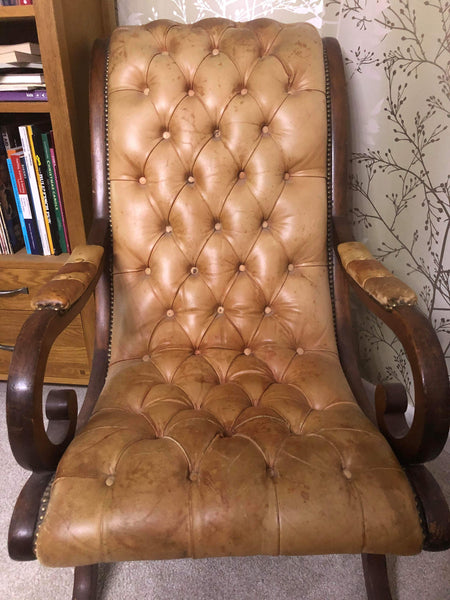A pair of antique buttoned leather lounge chairs that belonged to John Entwistle, bass player in The Who
