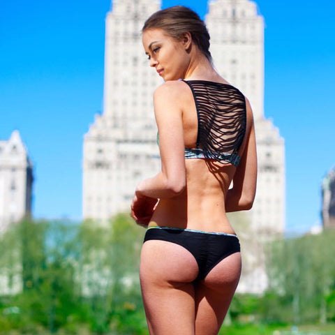 Adissa Bikini by Palheta Swimwear, cascading straps on back of bikini top in black. On model in NY at VaultXV
