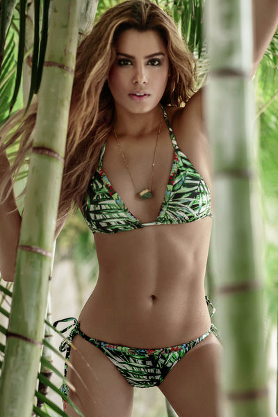 Bendito Mapora Bikini by Agua Bendita, modeled by Ariadna Gutierrez, tropical palm leafs print in green and white, triangle adejustable