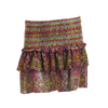 Bendito Ceremonia Girls Skirt by Agua Bendita, with ruffles and smocking in a printed mesh, front view. Pull on.