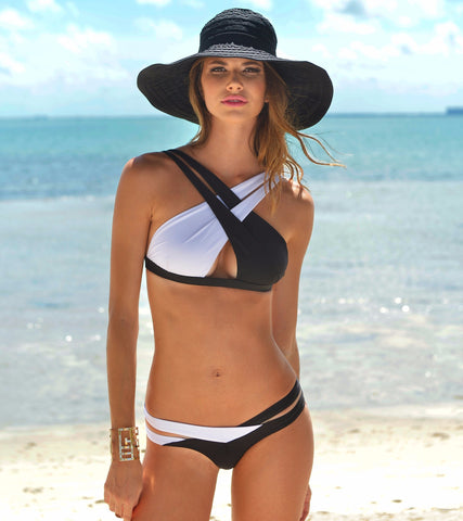 Charlie Bikini by Palheta Swimwear at VaultXV.com, on model at beach, crisscross black and white bikini