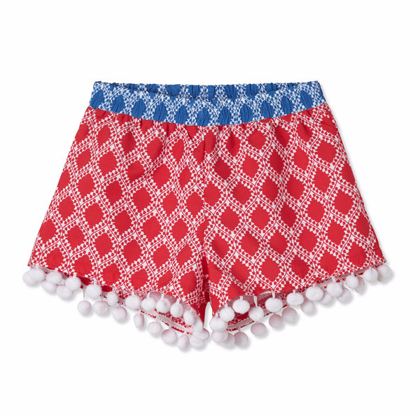 Girl Red Pompom Shorts by Stella Cove, detail of elastic waist, coordinated print and pompom trims