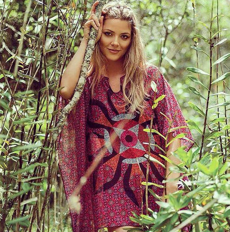 Dawn Manadala Tunic by Selvaki Swimwear at VautXV, model stands in forest with reds coverup