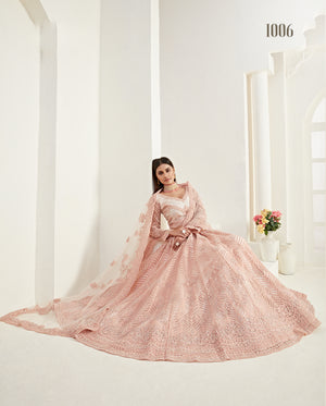 Embroidered Peach Net Indian Wedding Lehenga Designs