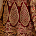 Maroon Embroidered Pure Velvet Silk Bridal Lehenga Choli In India
