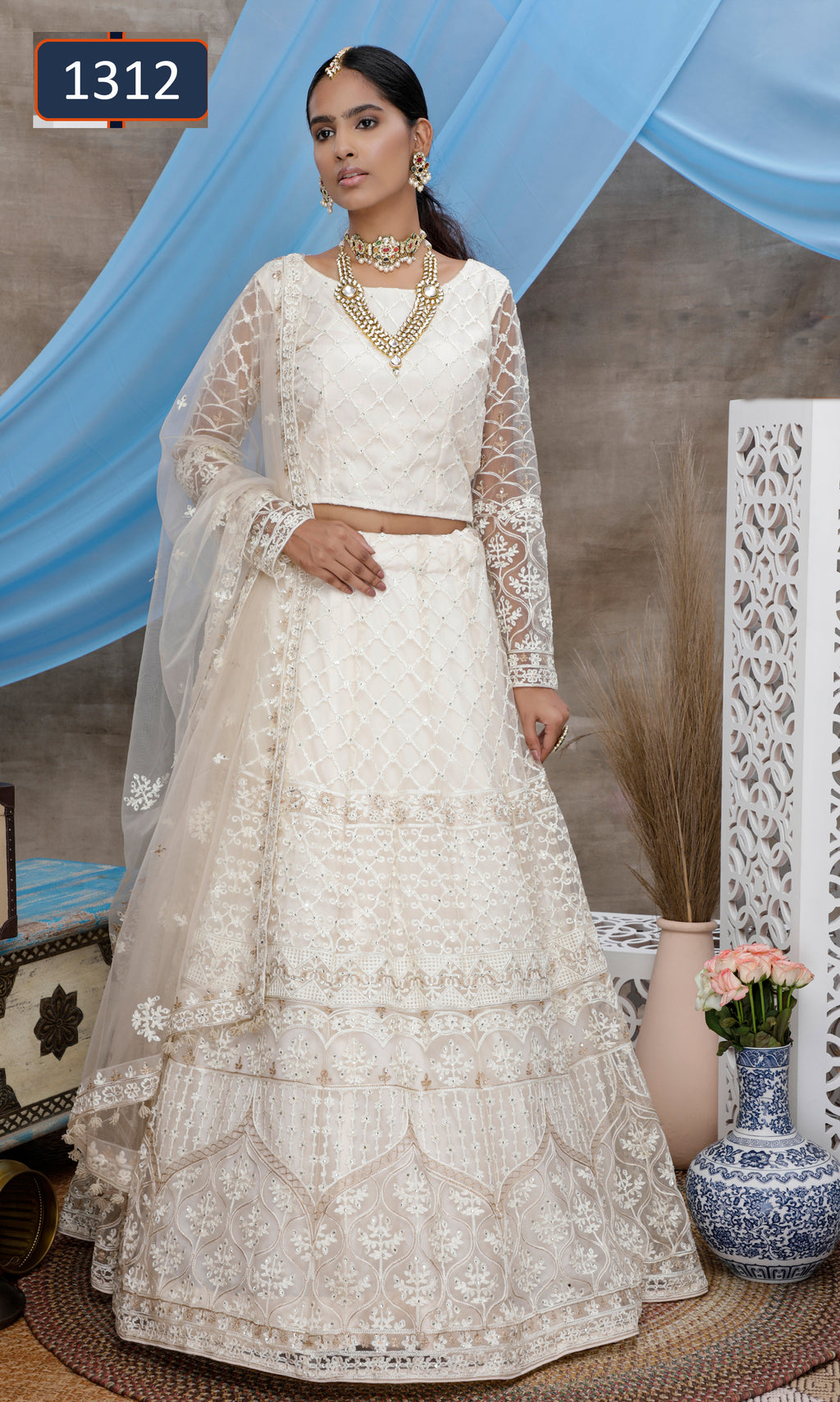 White Embroidered Net Fancy Party Lehengas Online