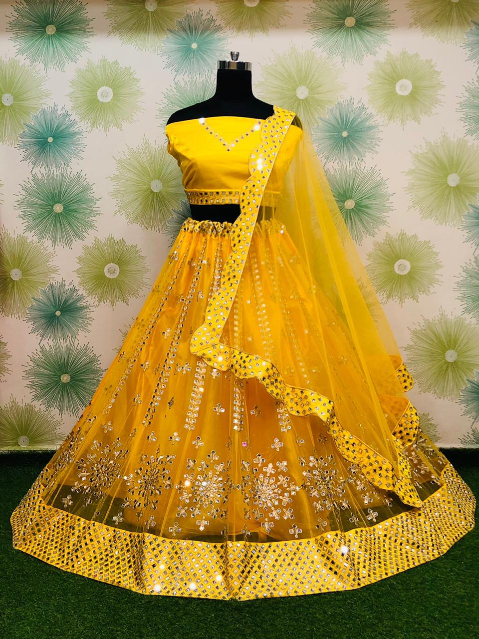 Yellow Net With Mirror Work Embroidery Fancy Lehenga Choli Online