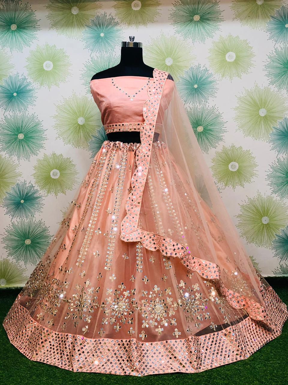 Peach Net With Mirror Work Embroidery Fancy Lehenga Choli Online