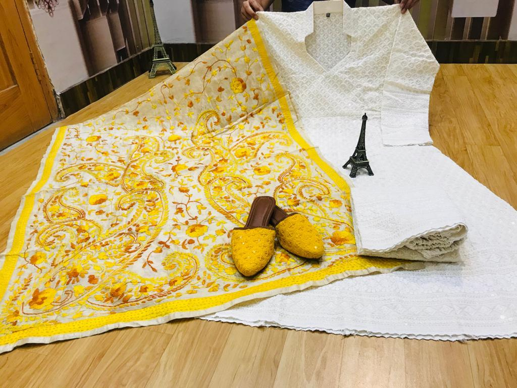 Beautiful Exclusive Yellow Phulkari Raw Silk Handwork  Dupatta And Chikankari Sequins Work  White Anarkali  And  chikan plazzo with Chikan Sequins Work Jutti Set