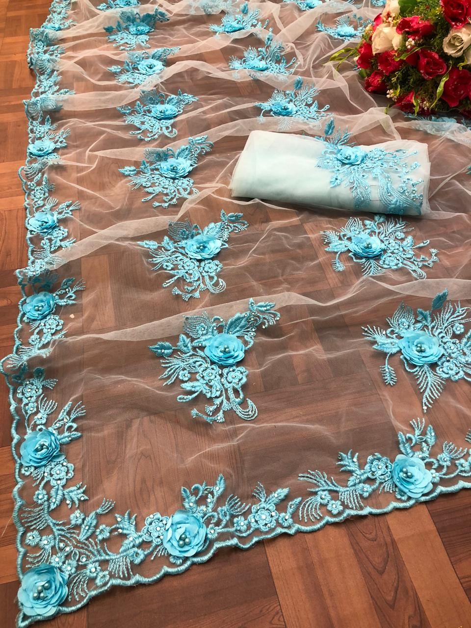 Light Blue Net Beautiful Stone And Ribbon Work Sarees Online
