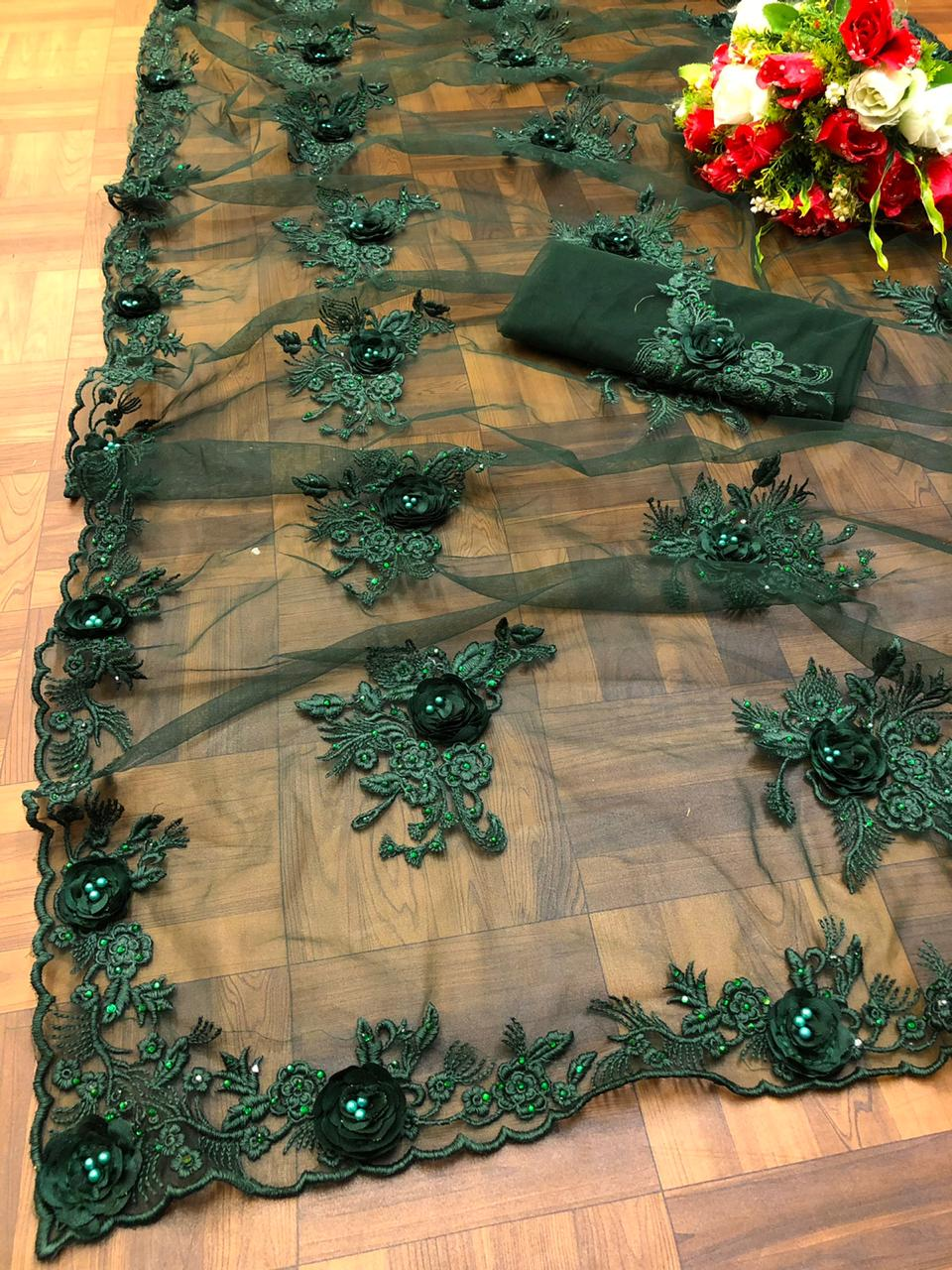 Green Net Embroidered Stone And Ribbon Work Party Sarees Online