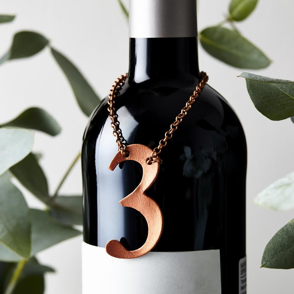 Perfect as a 3rd anniversary wedding gift - a leather bottle tag