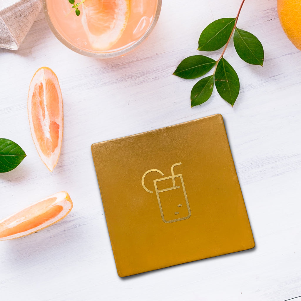 Square mustard drinks coaster with graphic juice symbol