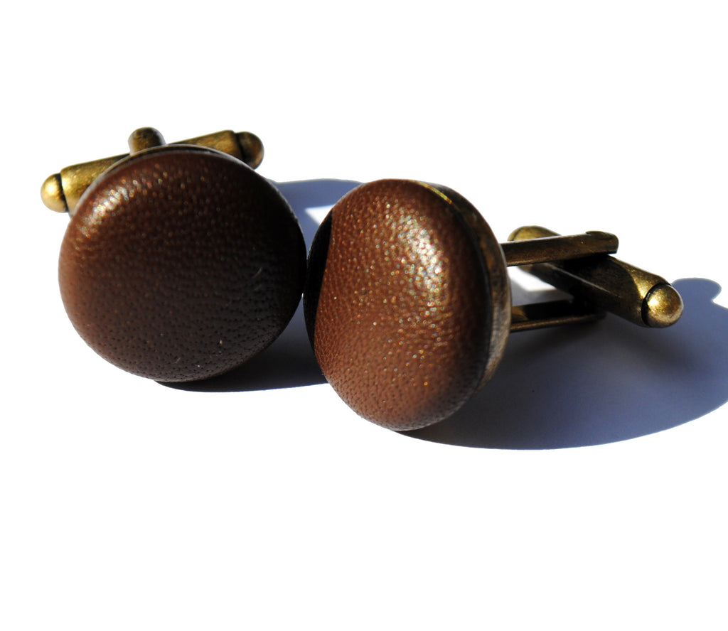 Brown leather cufflinks