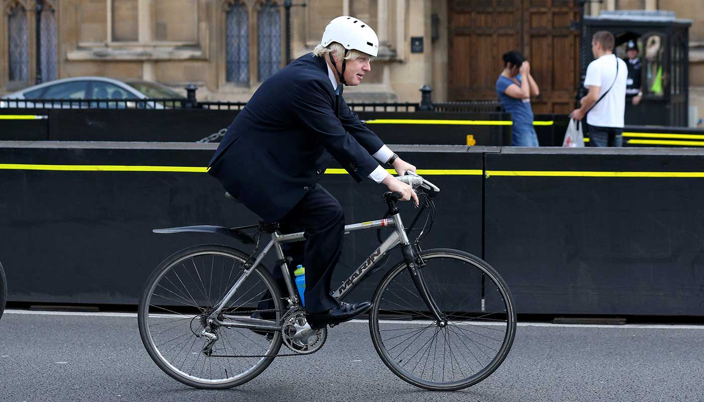 boris johnson celebrity on a bicycle