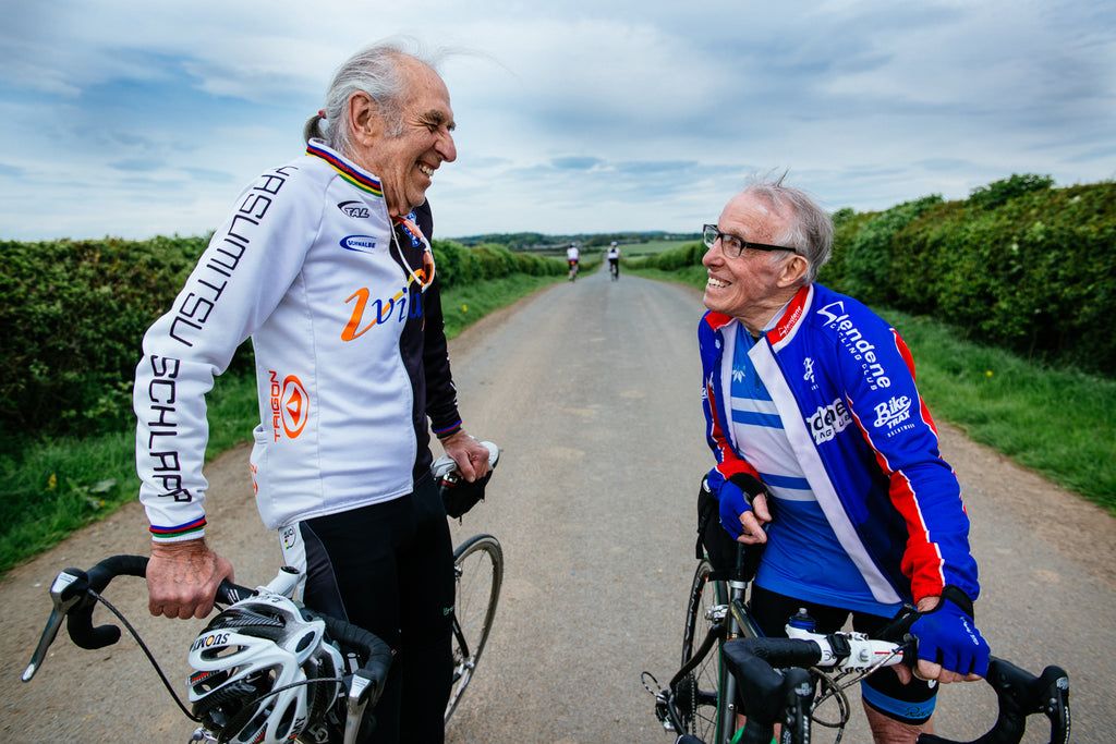 old men friends cyclists