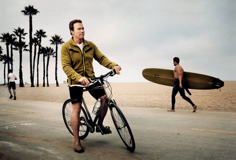Arnold Schwarzenegger on a bicycle