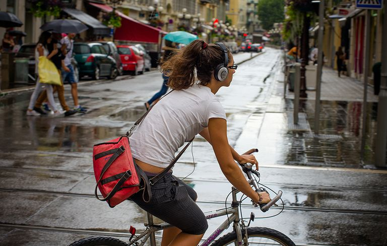Headphones on a bicycle rider