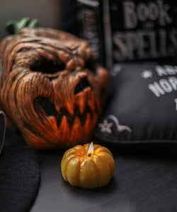 Halloween pumpkin candle for rituals and witches
