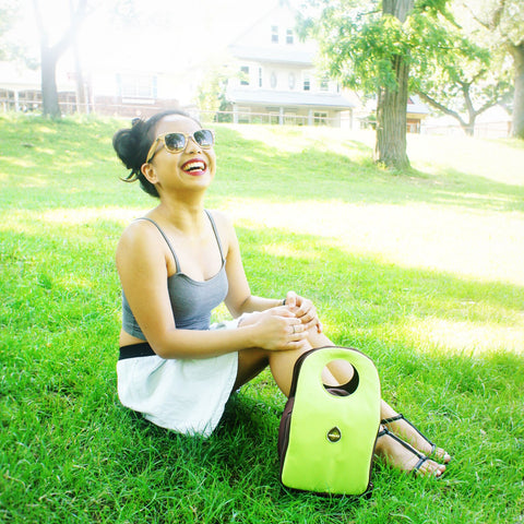 milkdot stoh lunch bag lime with woman in the park