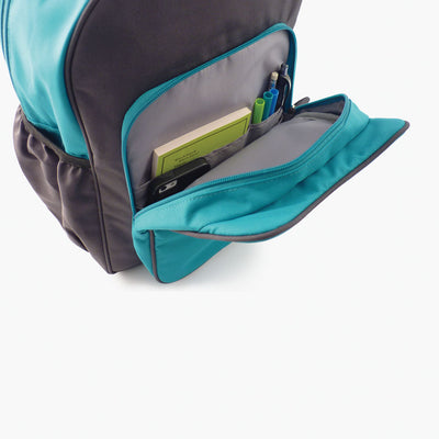 Open pocket view of blue and grey kids backpack by Milkdot.
