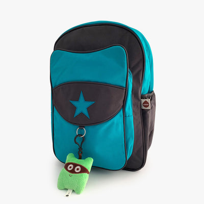 Blue and grey kids backpack with green plush keychain.
