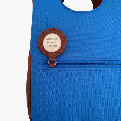 Milkdot blue insulated lunch bag with lunch note.