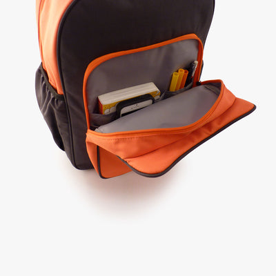 Open pocket view of orange and grey kids backpack by Milkdot.