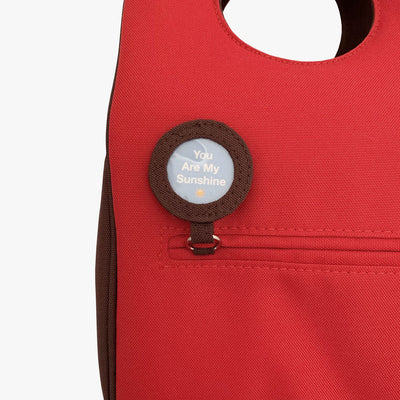 Milkdot red insulated lunch bag with lunch note.