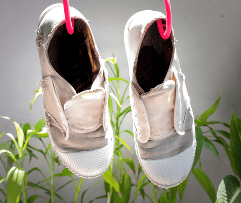 Hung canvas shoes dry under sunlight