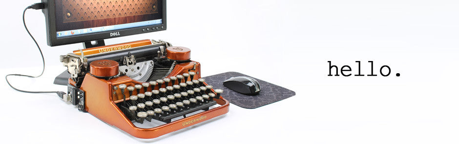 Beautiful Gold USB Typewriter plugged into desktop computer