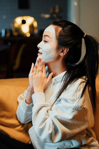 A Woman applying a Face Mask after using a Facial Steamer