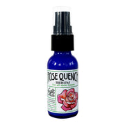 Rose quench serum skincare product in 1 oz blue bottle with black top with white label wrapped around