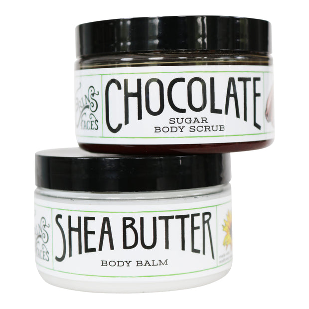 closed 4oz containers of one shea butter body balm moisturizer and one chocolate sugar body