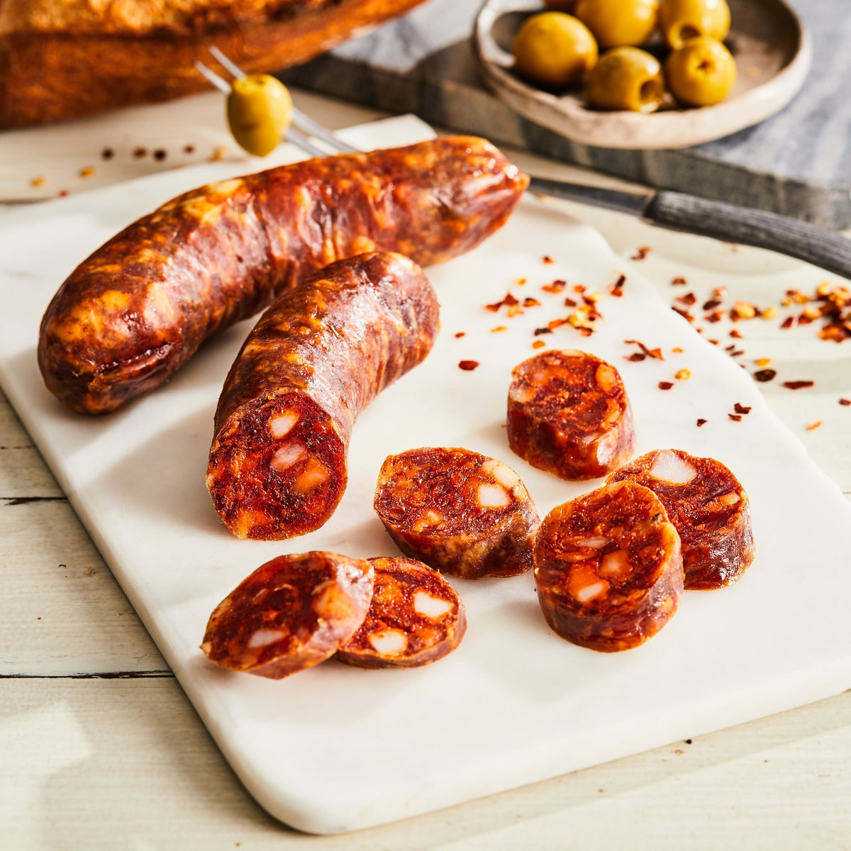 Image of Chorizo. 1 link, 3oz. a Spanish-style pork salami made with pimenton and garlic.