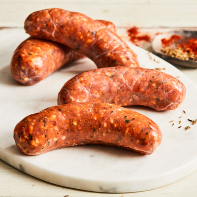 Image of Spanish Chorizo. 4 links, about 1 lb. a fresh Spanish-style sausage made with vermouth, garlic, and pimenton