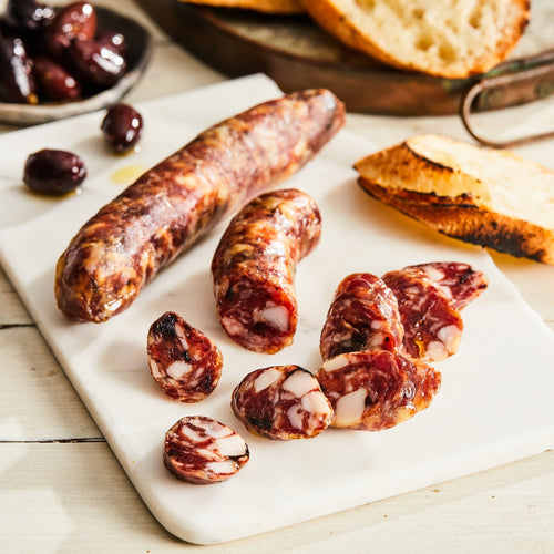 Image of Fernet & Olive salami. 1 link, 3 oz. a unique pork salami made with fernet branca, oil-cured olive, and preserved lemon.