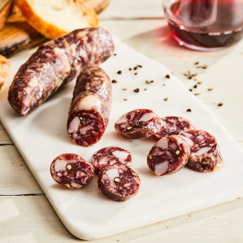 Image of Salchichon. 1 link, 3 oz. a classic Spanish pork salami made with white wine, toasted fennel and black pepper