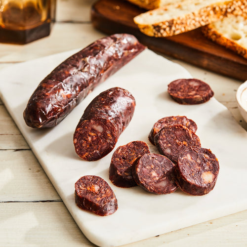 Image of Noir Salami. 1 link, 3 oz. a French-style pork salami with caramelized onion, black pepper, cinnamon, ginger, and pig's blood