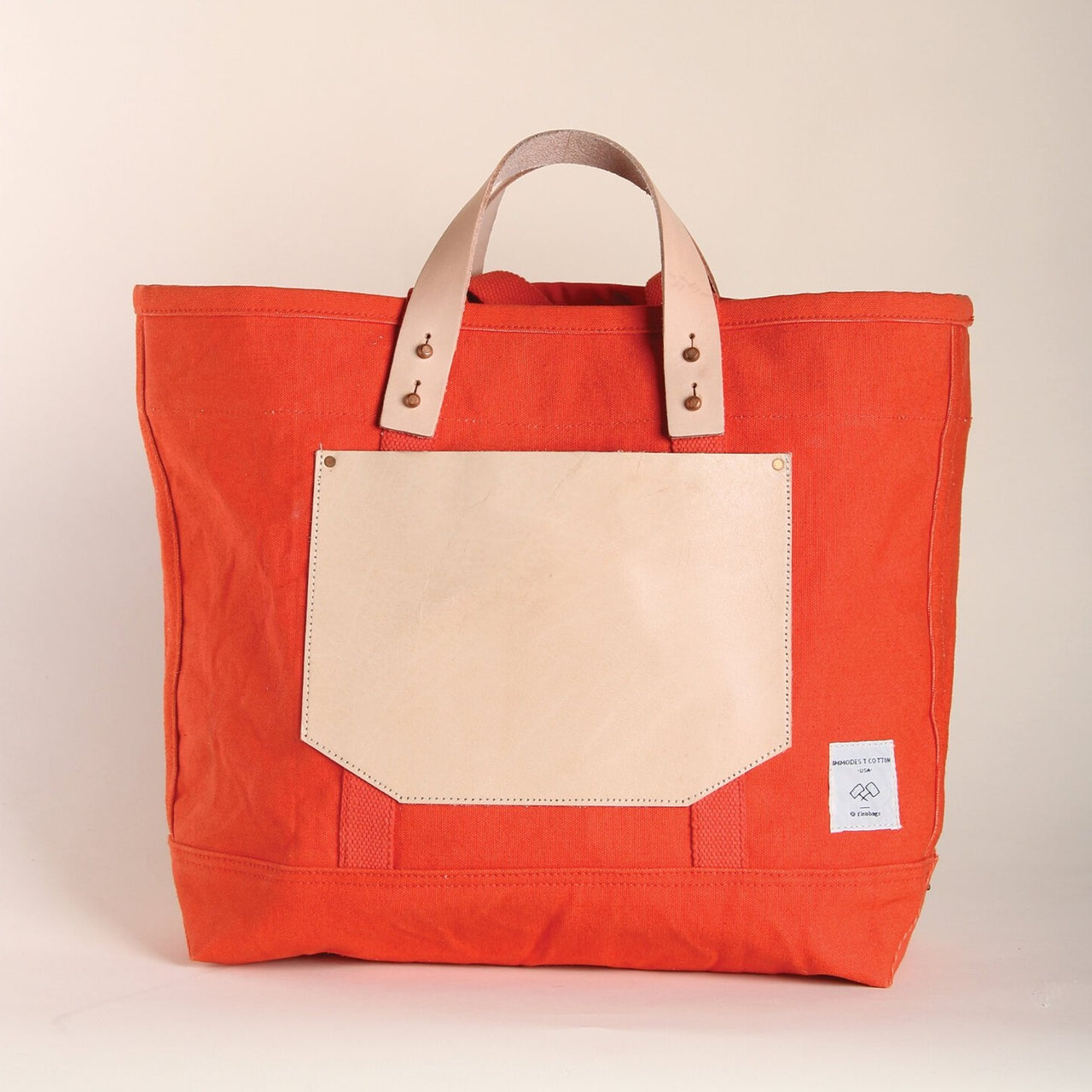 EAST-WEST POCKET TOTE PERSIMMON