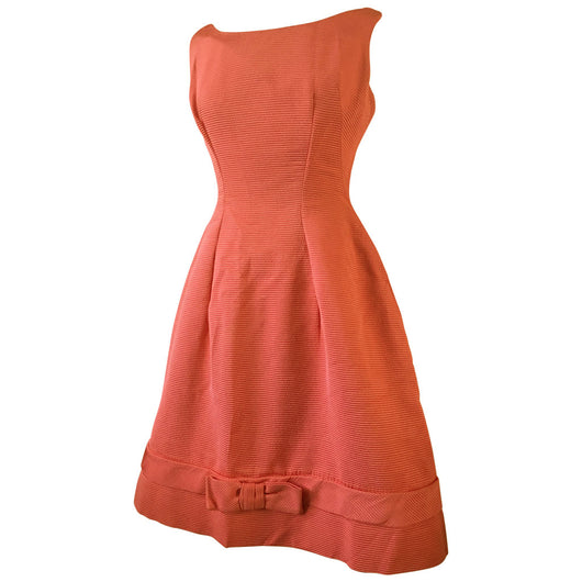 Coral pink rib textured late 1950s/early 1960s Carnegie party dress