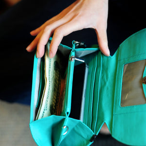 RFID Blocking Clutch - Rogue Industries - Ostrich Print Teal Open with Phone