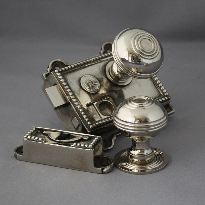 Nickel regency style bathroom rim latch with handles